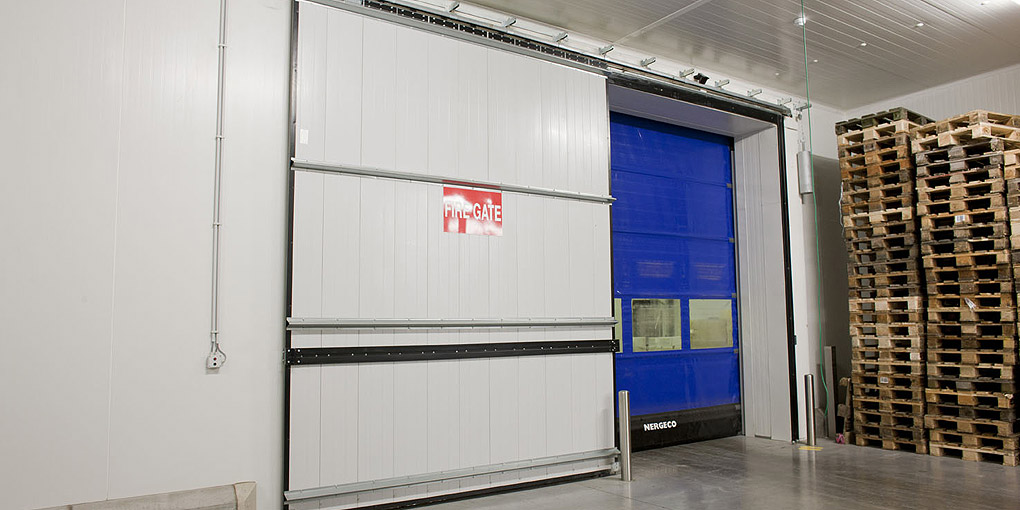 Fast acting door backed by a fire door