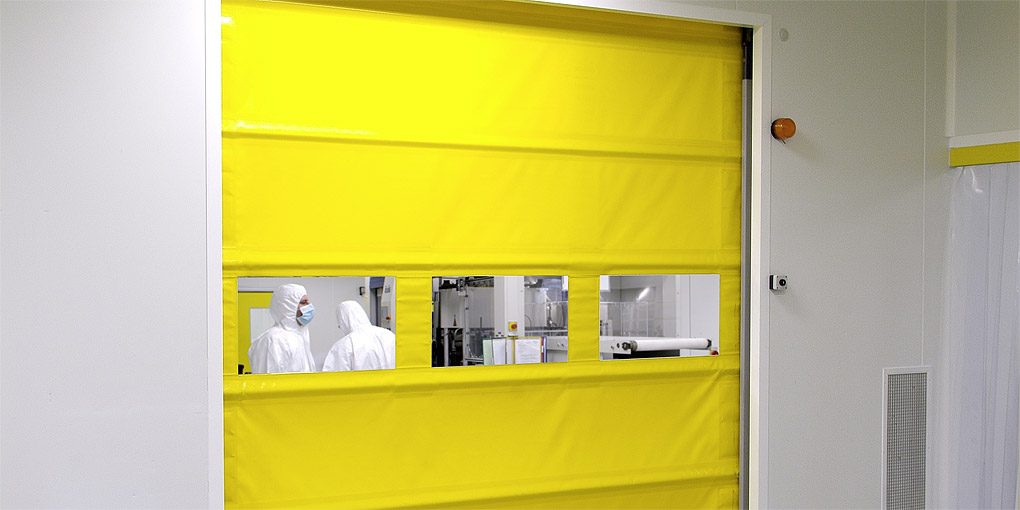 The panoramic transparency of the Nergeco rapid door also helps to make accesses safe. & Roll-up high-speed doors for clean pharmaceutical and lab processes
