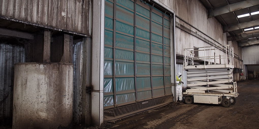High-speed flexible doors for corrosive environments